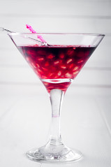 Pomegranate martini with  seeds in a glass (lyule4ik) Tags: cocktail drink pomegranate juice holiday xmas party background fruit summer leaf alcohol refreshment liqueur glass sweet red beverage fresh white gin cold condensation grenadine bar vodka copyspace refreshing tasty caribbean crushed reflection rum alcoholic vacation isolated slice berry delicious tropical cube hurricane studio ice dark long dew closeup ripe