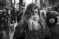 1.25cm Per Month (Leanne Boulton) Tags: people depthoffield monochrome urban street candid portrait portraiture streetphotography candidstreetphotography candidportrait streetlife man men male face faces facial expression look emotion feeling mood atmosphere hair beard shaggy bedraggled tone texture detail bokeh natural outdoor light shade shadow city scene human life living humanity society culture canon 7d 50mm black white blackwhite bw mono blackandwhite character glasgow scotland uk