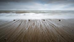 Happisburgh 26/11/2016 (Matthew Dartford) Tags: eastanglia beach blue bokeh coast coastal four happisburgh motion norfolk posts seascape shore shoreline stumps wave waves wet