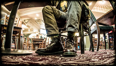 Under the table. (CWhatPhotos) Tags: cwhatphotos doc docs doctor marten martens air wair airwair bouncing soles original olympus fish eye lens cap selftimer 8 hole lace boots boot drmartens docmartens dms dark brown cushion sole yellow stitching yellowstitching foot laced laces photo photos picture pictures with that have dr comfort cushioned wear feet foto fotos which contain footwear 1460 1460s dm drmarten men mens legs under table tables floor view pub e5 mk2 omd durham city night out