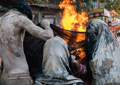 Iranian shiite muslim women gather around a bonfire after rubbing mud on their chadors during the kharrah mali ritual to mark the ashura day, Lorestan province, Khorramabad, Iran (Eric Lafforgue) Tags: 9people adultsonly ashura bonfire celebration ceremony chador colorimage commemoration culture festival fire firewood groupofpeople horizontal hussain imamhussein iran islam khorramabad man memorialevent middleeast mourning mud mudrubbing muharram muslim outdoors people religion religious ritual shia shiism shiite street tradition traditional unrecognizableperson veiled wet women lorestanprovince