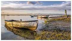Evening at Brancaster Staithe (Digital Wanderings) Tags: boats coast waterfront peaceful serene nationaltrust eveninglight brancaster northnorfolk brancasterstaithe norfolkcoast