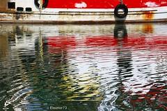 Colori annacquati (eleonor73) Tags: reflection water boat barca glare colours harbour tire porto acqua colori riflessi damper shockabsorber wavelet copertone imbarcazione increspature ammortizzatore