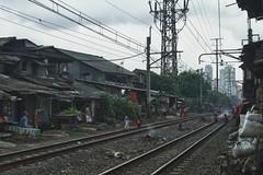 Pejompongan (Ragil Ticilius) Tags: city people building contrast canon eos cityscape jakarta slum slums selfportraitmanagement ragilticilius