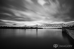Streaking Clouds (AP Imagery) Tags: longexposure bridge sky blackandwhite bw usa monochrome clouds downtown kentucky ky filter lee nd ohioriver owensboro bluebridge lte smotherspark bigstopper glovercary