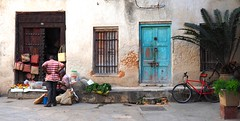 Stone Town Scene (Everything Colourful) Tags: africa street door blue man bike shop handicraft tanzania basket market outdoor handmade craft boutique conversation zanzibar tradition sell wicker trade negotiation