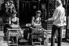 Your topic, your price (Culinary Fool) Tags: washington stranger reflection blackwhite 2016 september man 18135mm bw brendajpederson ballard street woman seattle busker writer wa culinaryfool farmersmarket