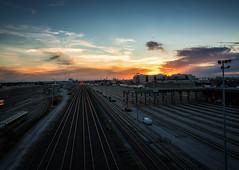 Tracks (Yewbert The Omnipotent) Tags: toronto canada lightroom urban city trains tracks sky clouds sunset nikon light colour