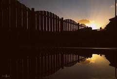 Mirrored sunrise (Fotogaaf ~ Amanda) Tags: sun sunrise garden fence mirror mirrored perception view depth ngc