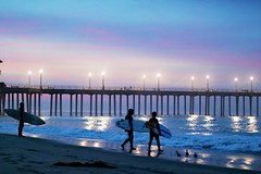 Glimmering Light (Madelynne F) Tags: surf huntington beach pier california surfing surfer waves sunrise light shimmer photography ocean morning soft love beautiful amazing boards reflection