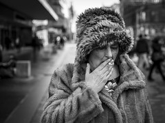 Fur-Lining (Leanne Boulton) Tags: monochrome depthoffield people urban street candid portrait portraiture streetphotography candidstreetphotography candidportrait streetlife closeup old elderly woman female face facial expression look emotion feeling fur hat coat winter clothing weather smoke smoker smoking cigarette inhaling tone texture detail bokeh bokehlicious natural outdoor light shade shadow city scene human life living humanity style culture fashion canon 5d canoneos5dmarkiii 50mm character ef2470mmf28liiusm black white blackwhite bw mono blackandwhite glasgow scotland uk