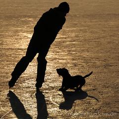 Silhouettes on ice (explored) (Ruud.) Tags: ruudschreuder nikon nikond300 d300 schaatsen skating schlittschuh laufen ijs ice eis glace slhouette hond hund dog chien monty