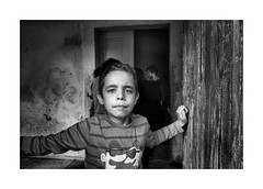 Boy with the big eyes (Jan Dobrovsky) Tags: bw contrast countrylife countryside document grain indoor krasnalipa leicaq portrait roma rural village gypsies
