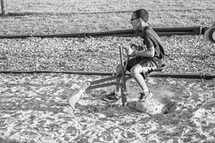 Jayden Having Fun (FitzJohnson) Tags: blackandwhite bw blackwhite monochrome monochromatic canon canonrebel t3i child kid fun spinning sand dizzy park