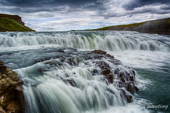 Gullfoss or Golden Falls  in Iceland.  These falls have the equivalent hydroelectric potential as Niagara Falls, but they are protected and will never be damned for power. Multi-raw processed Photomatrix HDR (stevebfotos) Tags: iceland south waterfalls gullfoss hdr goldenfalls