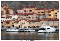 porto piccolo 2 (Giorgio Serodine) Tags: mare colore tetti barche case porto acqua montagna molo finestre baia