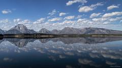 May Tranquility Prevail (Neha & Chittaranjan Desai) Tags: usa lake clouds nationalpark skies hole jenny grand jackson yellowstone wyoming tetons blus