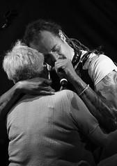 Hillside Embrace (peterkelly) Tags: bw musician music woman ontario canada man mike digital concert hugging hug singing guelph singer northamerica microphone hillside spearhead michaelfranti 2015 hillsidefestival guelphlakeconservationarea