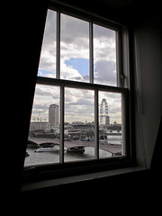A view from Kings (Gary Kinsman) Tags: waterloobridge 2006 london wc2 view skyline cityscape clouds sky architecture buildings highrise tower river thames aldwych window kcl kingscollegelondon hungerfordbridge millbanktower londoneye mainbuilding shelltower upstreambuilding