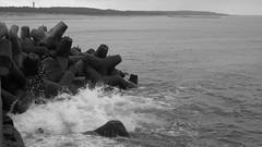 Stones  and splash (navarrodave80) Tags: stones splash sea baltic pier shoreline monochrome blackwhite bw marine canon