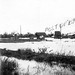 1942 Flood, Rannes (Central Queensland). The 2-storey Rannes Post Office is partly-submerged. Photo taken from trucking yards.