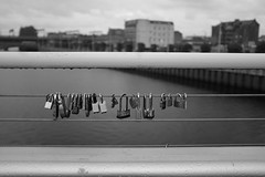 Come together (Lucky Poet) Tags: clyde glasgow scotland squigglybridge blackwhite love monochrome padlocks railing rain river wet