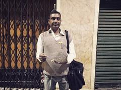 A Portrait of The Delhi Walla as the Pavement Seller of Head Massager (Mayank Austen Soofi) Tags: delhi walla connaught place a portrait the pavement seller head massager