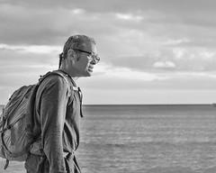 Walking the Beach at Sunset (Oliver Leveritt) Tags: nikond7100 afsdxvrnikkor18200mmf3556gifed oliverleverittphotography hawaii oahu waikiki waikikibeach man monochrome blackandwhite sunset beach ocean