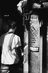 Happy Herb (35mm) (jcbkk1956) Tags: bangkok thailand street man thai thonglo film analog manual rangefinder yashica ministerd ilfordpan100 ilford 35mm streetfurniture stickers mono blackwhite yashinon worldtrekker