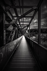 The walk way (lja_photo) Tags: bridge brcke saarbrcken germany europe exploration exposure urban urbex street streetphotography steel construction abstract decay detail old train black white blackandwhite bnw city monochrome monotone monoart moody light natural sky clouds contrast