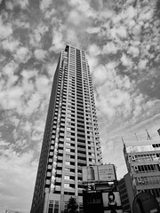 High-rise apartment (Woodenship) Tags: tokyo urban city building japan streetscape skyscraper cloud sky monochrome blackandwhite nikon coolpix s9500 architecture