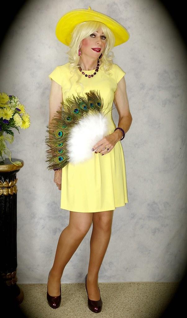 DSC06032 (msdaphnethos) Tags: hat yellow fan tv cd tgirl transgender  chapeau blonde transvestite