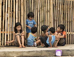 Discussion Time (Beegee49) Tags: street city home boys girl fence children sitting philippines bamboo bacolod bata talking