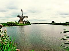 idyllic Holland (Timmie10) Tags: kinderdijk holland netherlands water windmill boat idyllic landscape