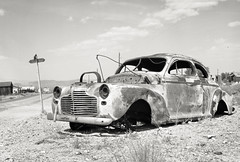 Stranded (magnetic_red) Tags: car old rusted busted stranded roadside corner sign desert nevada abandoned grill ghosttown american west blackandwhite crowngraphic tmax100 caffenol
