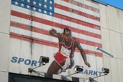 151209_SAM_3420 (Jan Jacob Trip) Tags: leiden stars stripes sports flag wall shop publicity athlete blue red spotlights jump