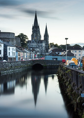 St Fin Barre's Cathedral and the River Lee (Joe Dunckley) Tags: cork countycork ireland republicofireland riverlee stfinbarrescathedral architecture building cathedral church longexposure river sunset water