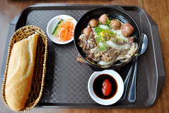 Breakfast tray (Roving I) Tags: breakfast dining food breadrolls baskets trays beef eggs potatos pickles sauce cutlery malls foodcourts vincomcenter vietnam danang