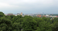 Cleveland (in Haze) (Pythaglio) Tags: cleveland skyline landscape cityscape view scenic pleasant hazy haze city cuyahoga county ohio james garfield monument trees leaves greenery buildings structures skyscrapers cloudcover overcast