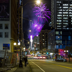 Lighting of the Macy's star and mini fireworks show that followed. (Brendinni) Tags: seattle seattlewa macys star fireworks citystreet streetphotography cartrails people festive purple dawgs pnw pnwcollective washingtonstate buildings lights cranes architecture paramount fence
