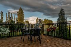 Auf der Terrasse-On the terrace (Jutta M. Jenning) Tags: terrasse wolken himmel abend landschaft wiese baeume tisch stuehle erholung freizeit terrace outdoor landscape