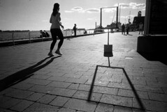 (flaxendream) Tags: 35mm film ricohgr1v ilfordhp5 bw blackandwhite monochrome analog lake shadow silhouette runner running athlete harbourfront toronto canada
