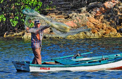 Fisherman casting Nets Cuba