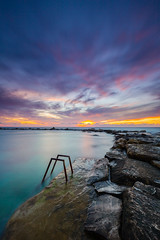 A swim with a view (billydorichards) Tags: tranquil meditteranean landscape sunset serene vibrant waterblur vacation canon6d holiday shore cyprus wintersun travel vivid canon1635mmf4l islandlife sea coast chloraka paphos cy