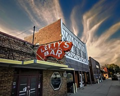 Lefty's Bar (Pete Zarria) Tags: minnesota bar saloon tavernliquor beer wine sky clouds sign neon dead ghost decay small city town america