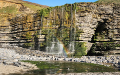 Waterfall Rainbow (Andy.Gocher) Tags: andygocher canon100d 1855mm europe uk wales southwales dunravenbay southerndown treathmawr waterfall rainbow beach