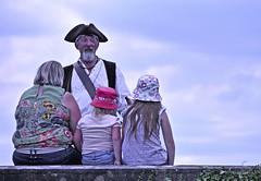 The Storyteller (Dreamsmitten) Tags: blue sky wall children audience mother story listening parent pirate sailor seated storyteller oldseadog