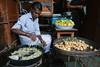 Frying Bonda, Borsad India (AdamCohn) Tags: india man adam streetfood cohn bonda chaat borsad adamcohn wwwadamcohncom