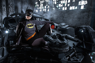 Batman poses with batmobile and red pepper
