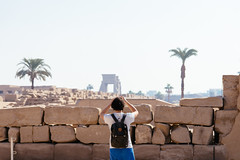 Tourist photographing the vast area of Karnak temple, Luxor (Egypt, 2014) (Steffen Kamprath) Tags: architecture decayed desert documentary light luxor people religion sight sonya77 temple travel gouvernementaluqsur ägypten availablelight history ruin tamronspaf1750mmf28xrdiii slt dslr apsc environmentalportraiture backlight amount zoomlens man bygonetimes olddays ancient lostcivilization hulk attraction spot landmark tourism traveldestination travelphotography traveling vacation africa afrika afrique áfrica egypt egipto egypte egito